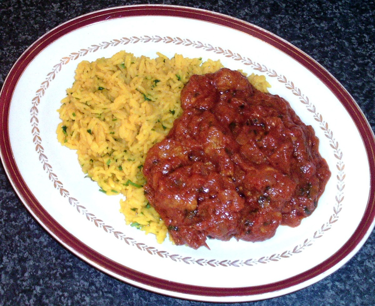 Spicy turkey curry is served on a bed of turmeric rice