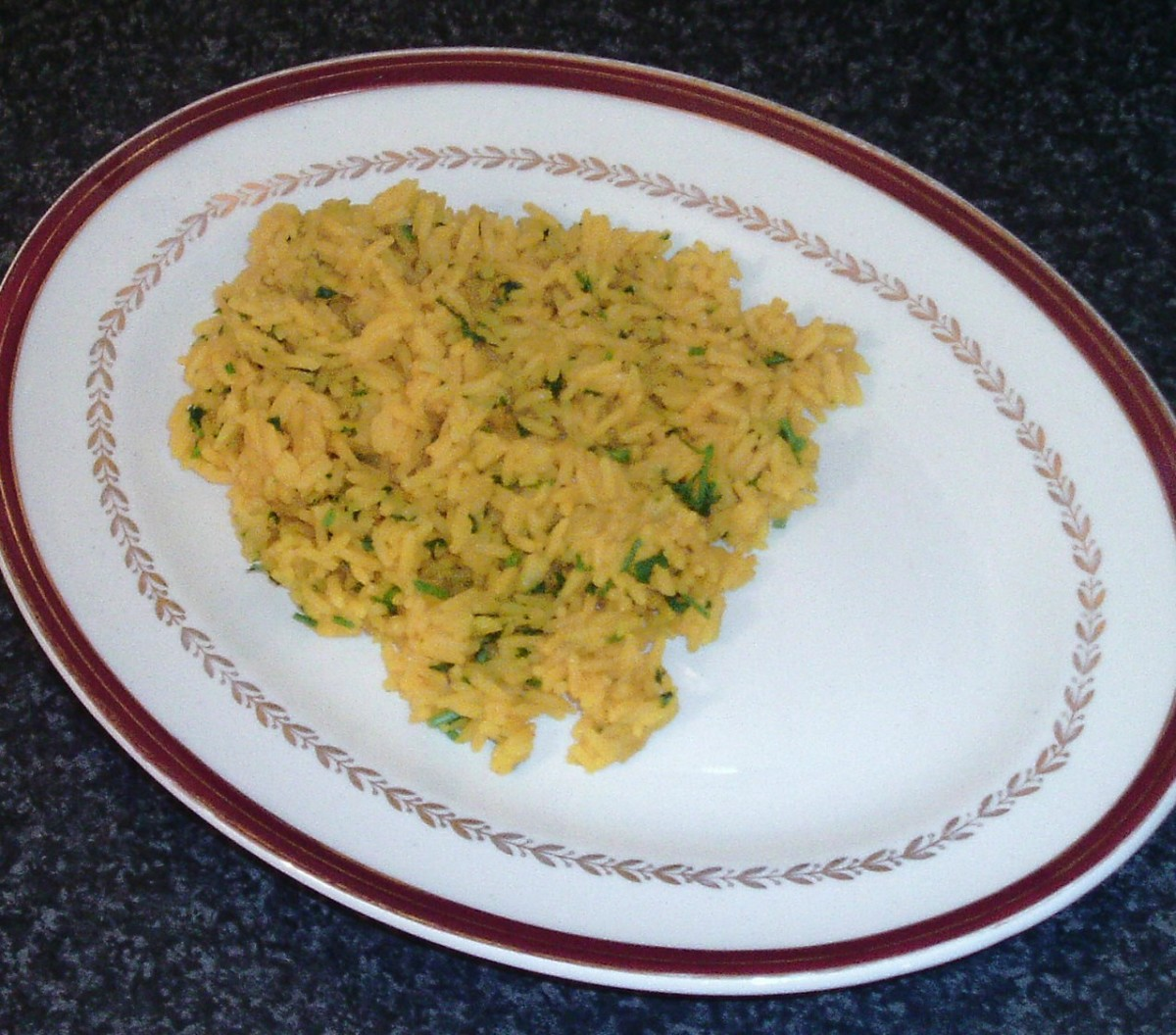Turmeric rice bed is arranged on serving plate