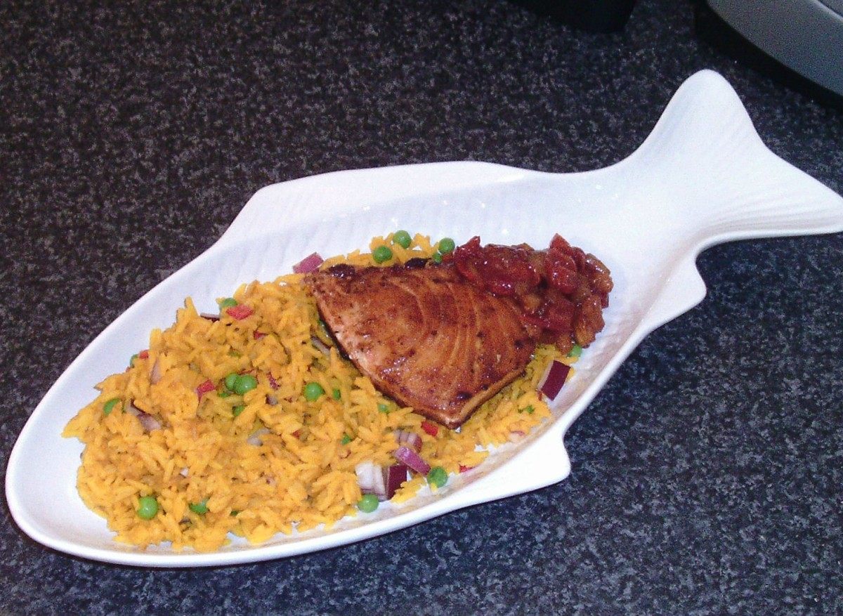 Spiced marlin fillet is served on turmeric rice with homemade tomato and pineapple chutney