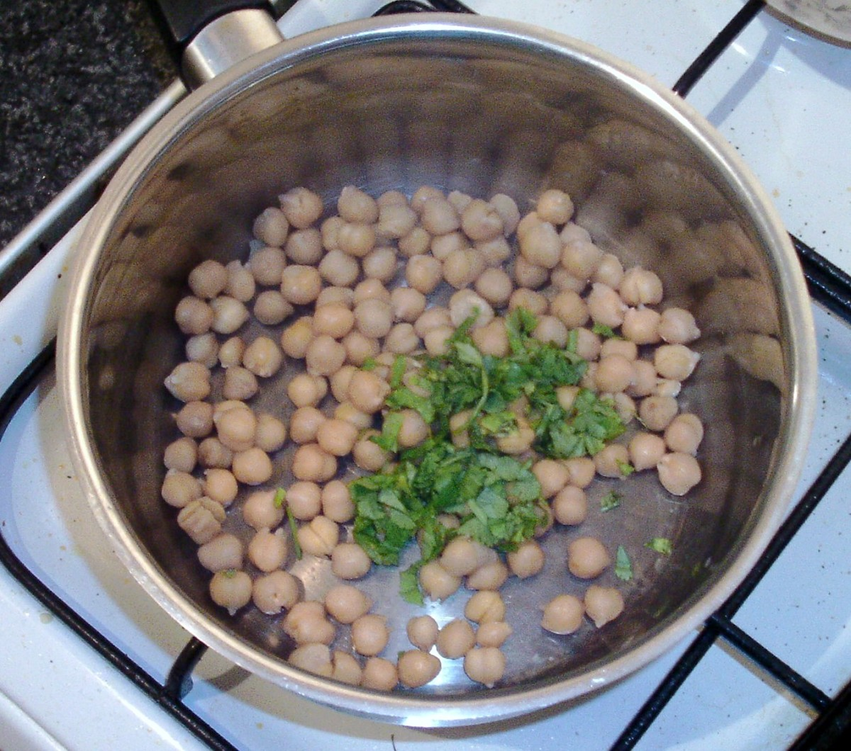 Coriander is added to drained chickpeas
