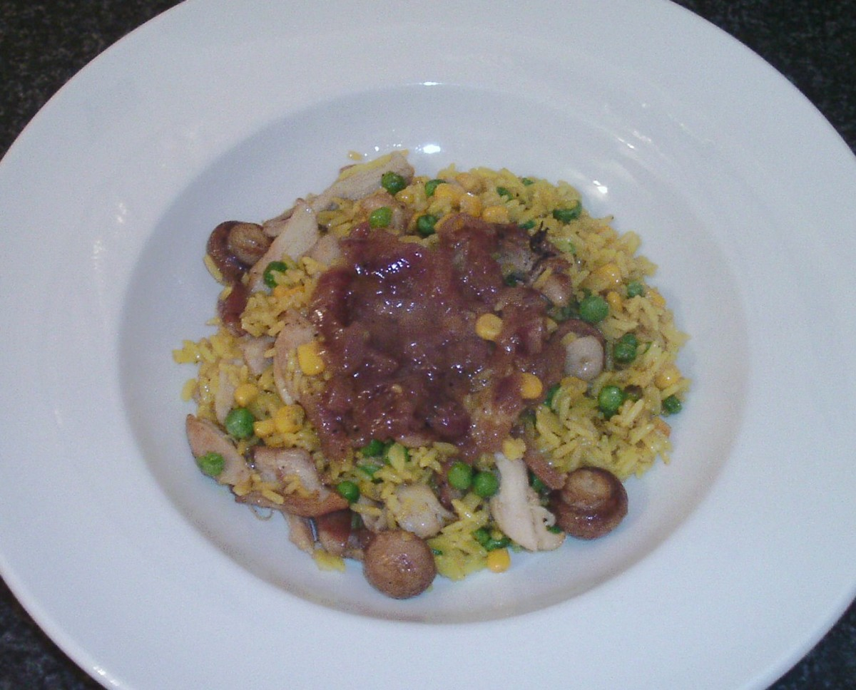 Chicken and mushroom Turmeric fried rice is served with red onion gravy