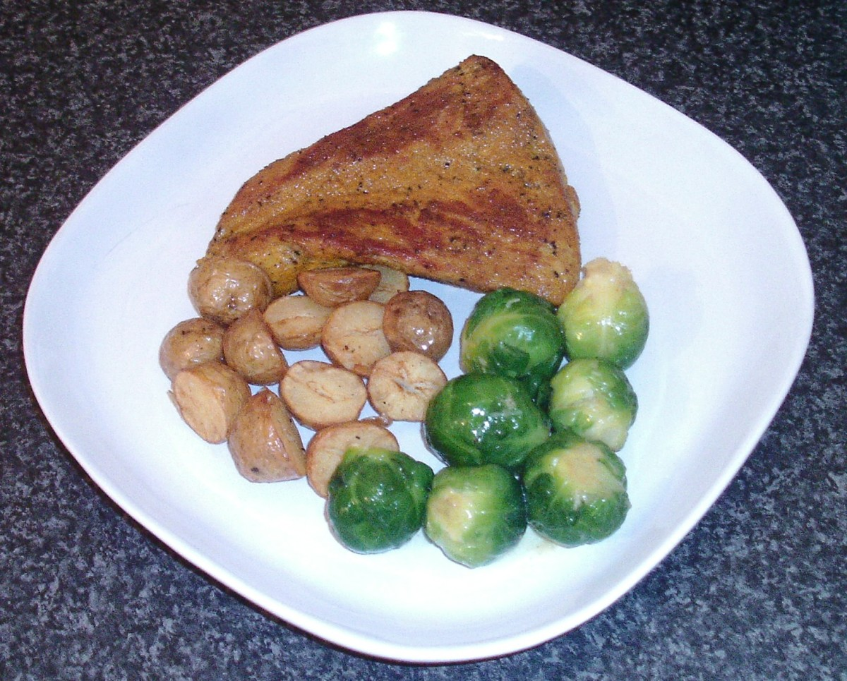 Turmeric spiced pork tenderloin fillet with Brussels sprouts and deep fried potato halves