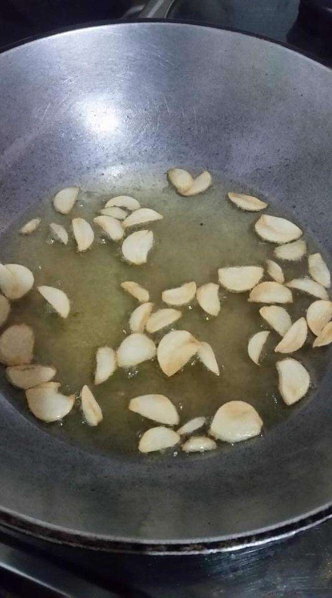 Add the garlic to the pan and cook until it becomes light brown.