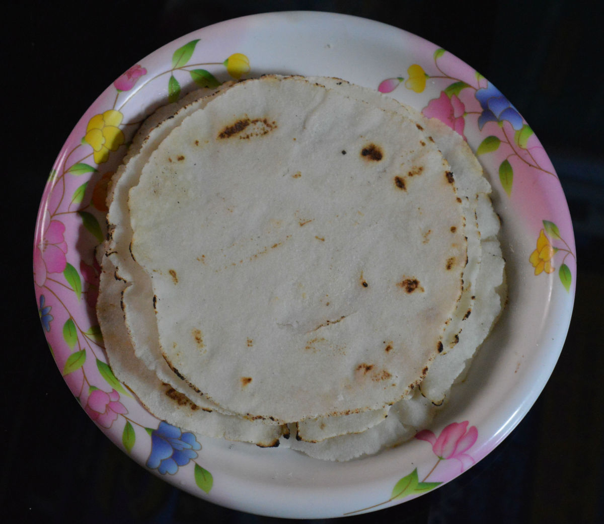 Step four: Make all rotis in the same way. Collect them in a casserole.