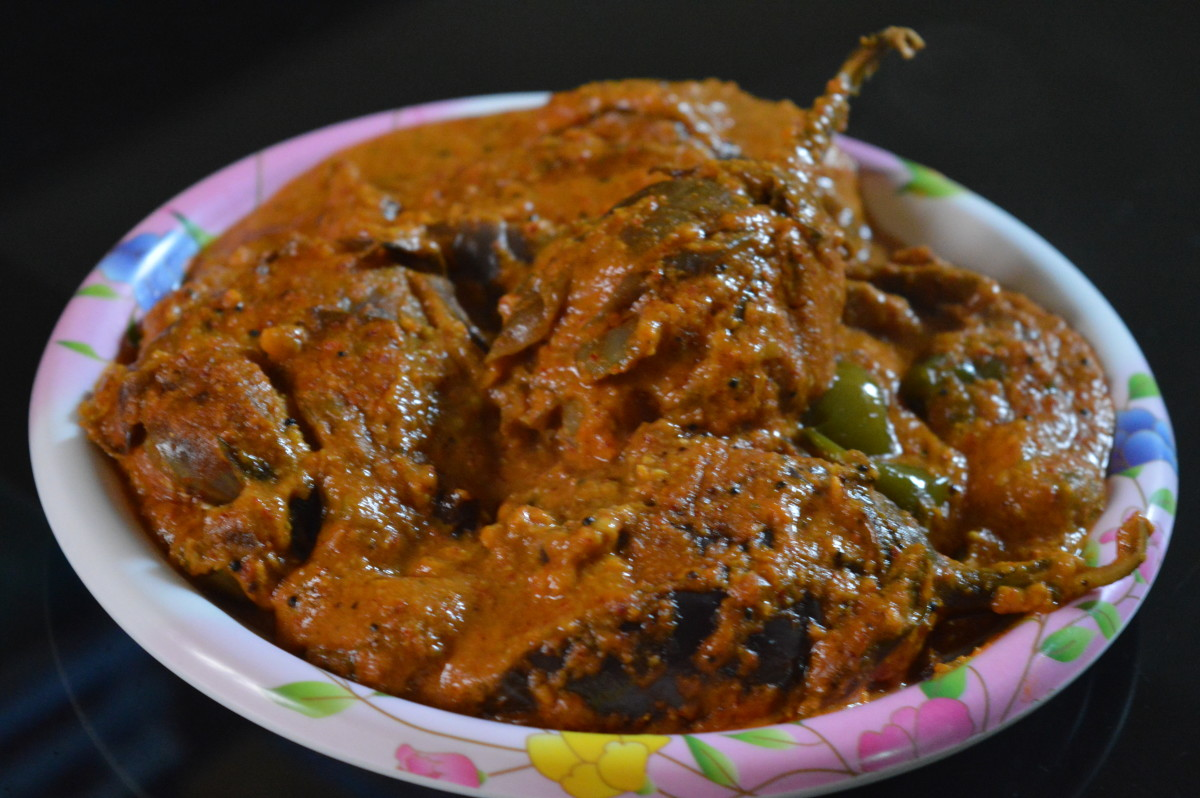 Spicy stuffed brinjal eggplant curry or Badanekai ennegai.