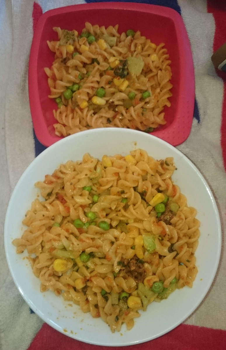 Gluten-free vegan pasta with vegetables (my son's plate on top, mine on the bottom).