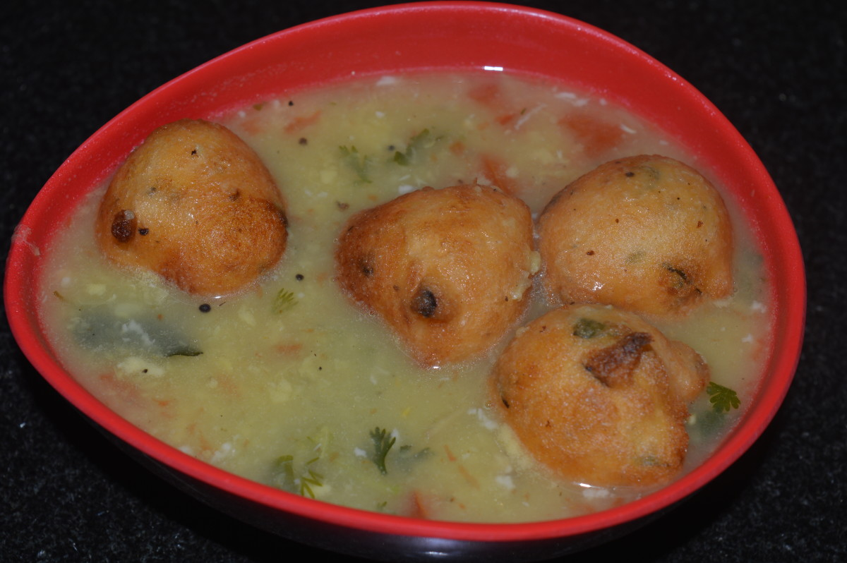 Step eleven: Serve 3-4 ladles of soup in a bowl. Place 3-4 lentil balls on this piping hot soup. Happy eating!