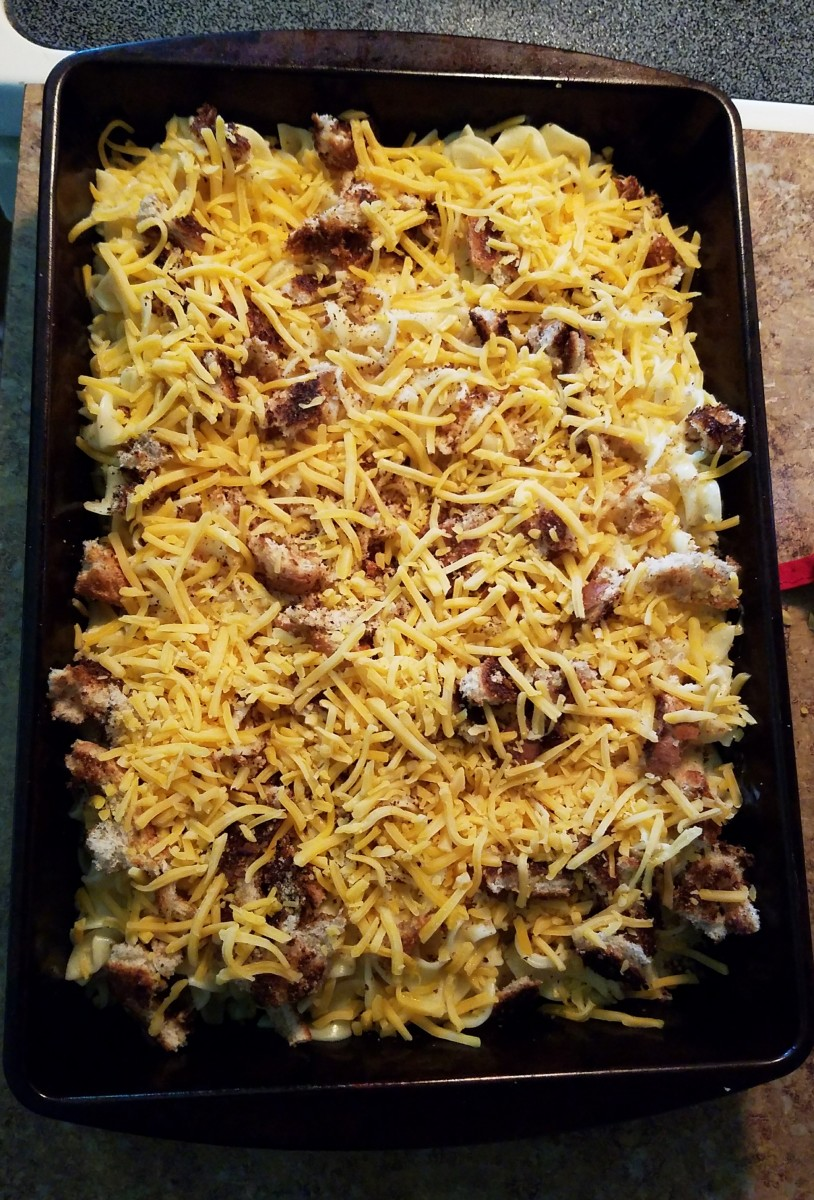 Sprinkle shredded cheese on top of macaroni. Bake for 30 minutes.