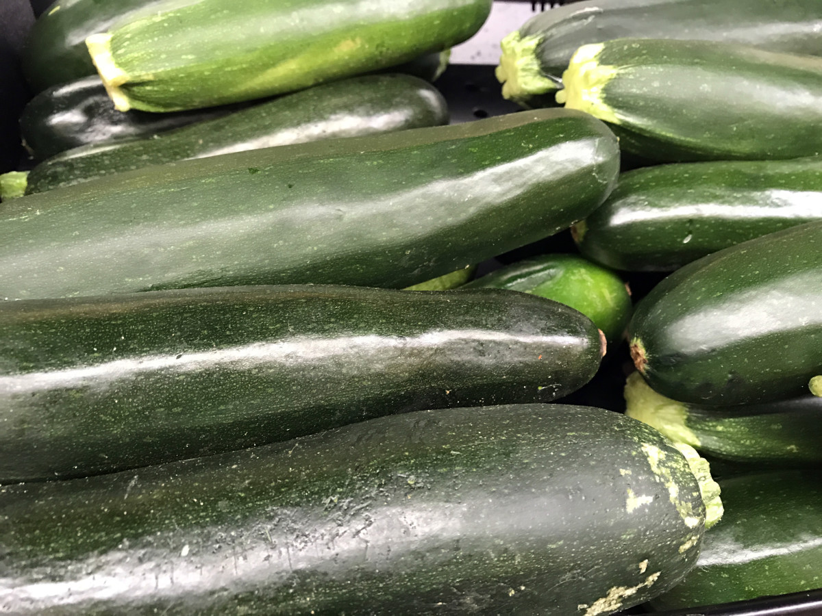 Zucchinis vary in quality, so pick yours carefully.    It can impact the taste of your recipe.  There is no need to peel the skin off zucchinis.  However, remove the ends and wash the outside well.