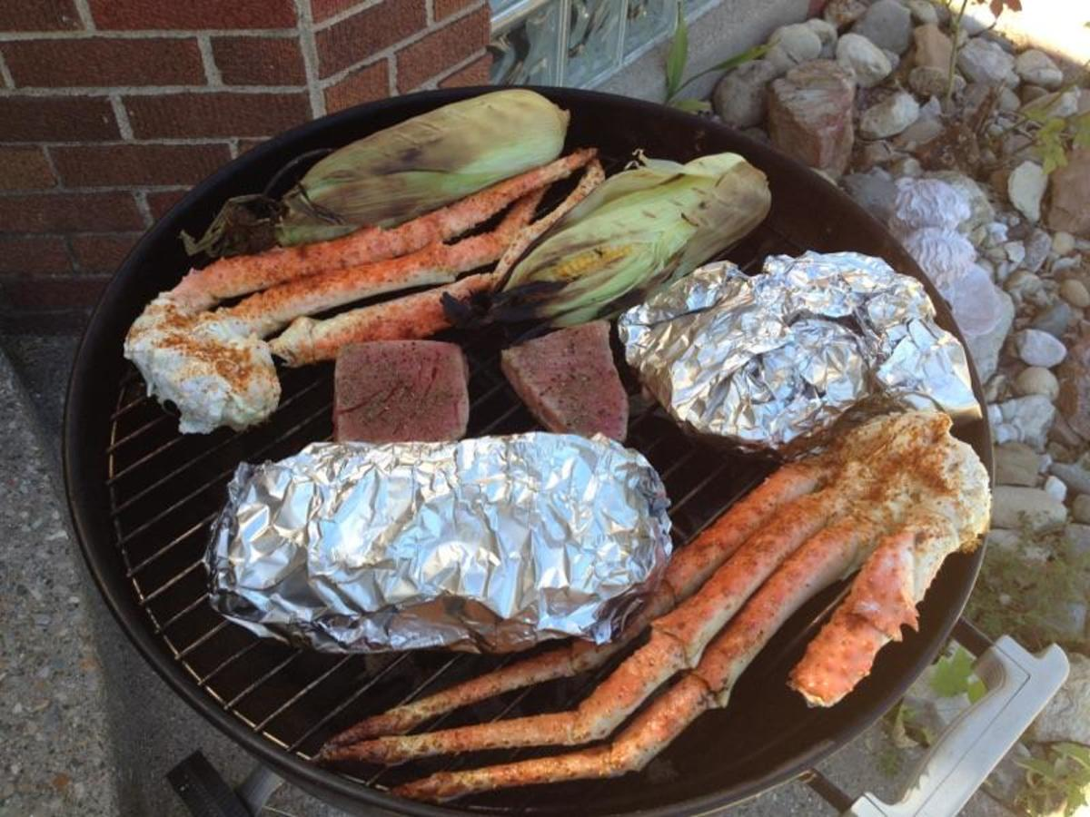 Seafood and vegetables on a grill.