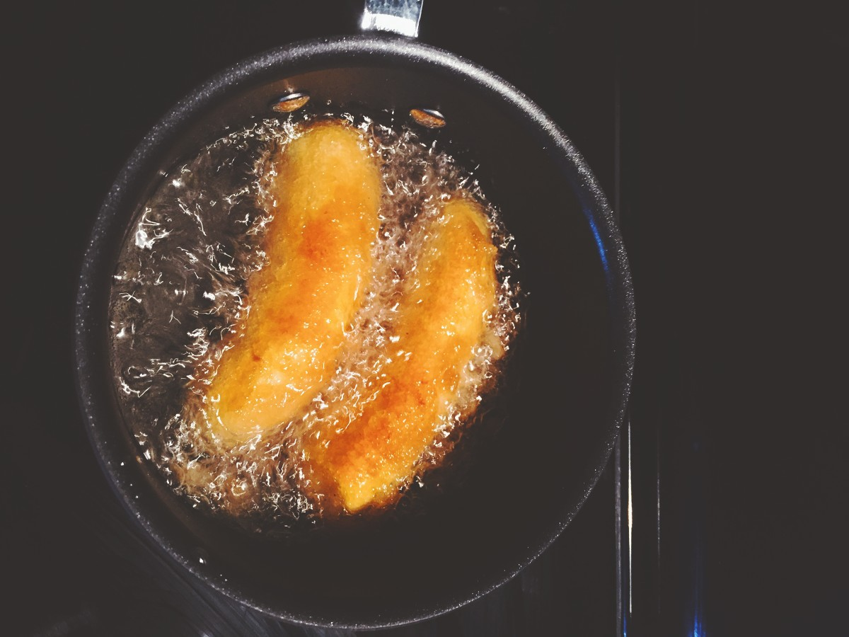 Fry the bananas for a few minutes or until they turn golden brown.
