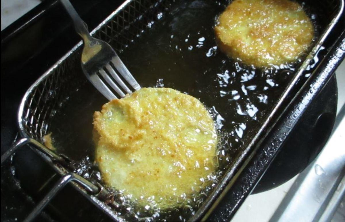 Place into dip fryer. Let egg set for a couple seconds.