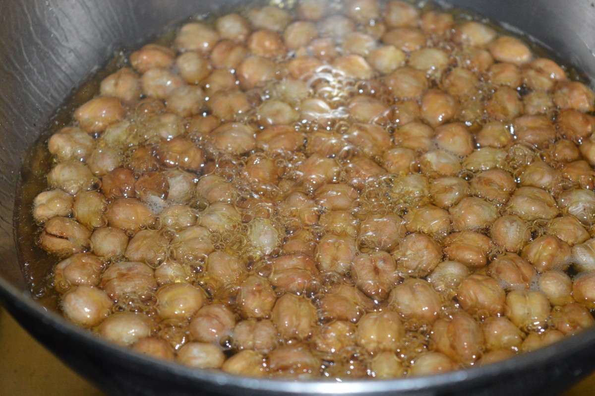 Observe, in the last stages of frying, chickpeas float on the surface