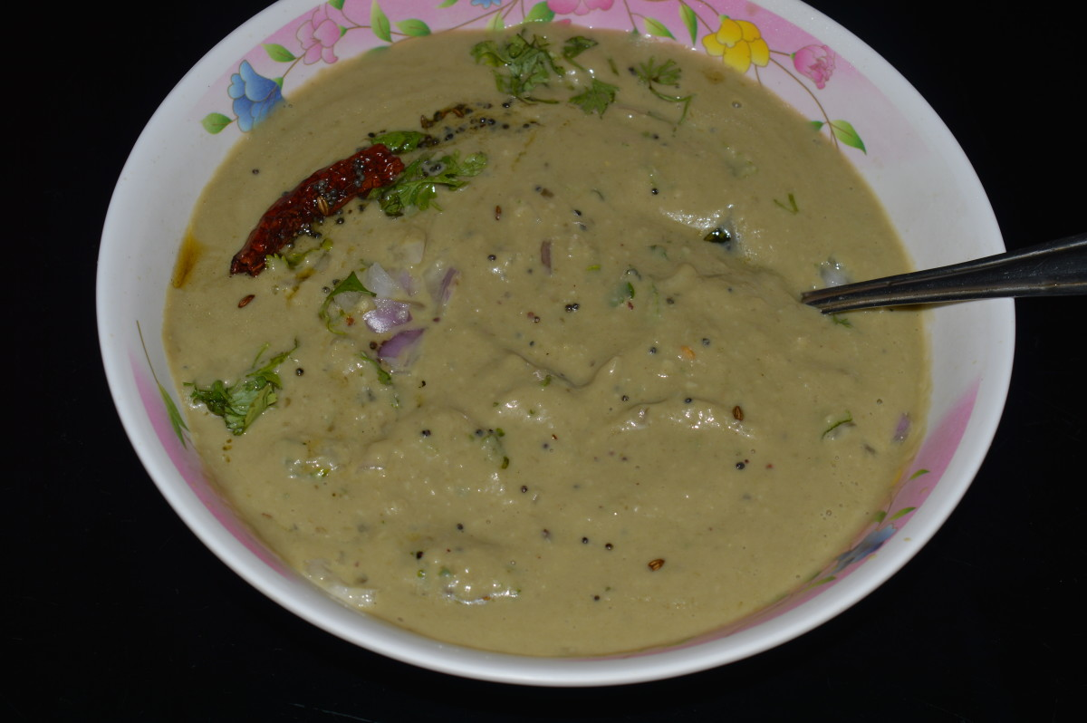 Step nine: Long green eggplant(brinjal) raita is ready to serve. Mix well. Eat it with plain boiled rice or any other spicy rice main course dishes or pancakes. Enjoy the taste!