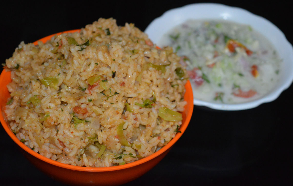 Step nine: Spiced cabbage rice is ready to serve. Eat it with cucumber-onion raita on the side. Enjoy!
