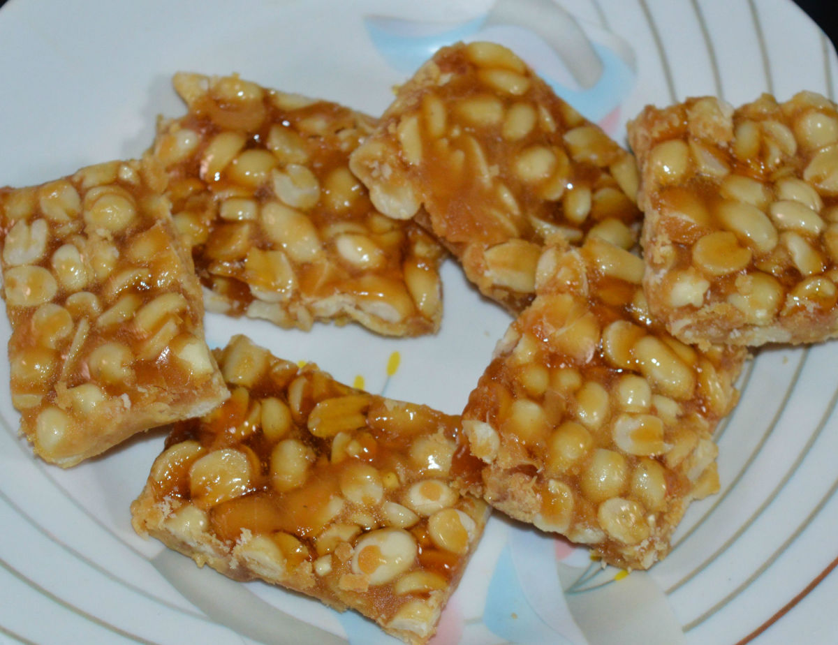 Peanut chikki is ready. Eat these crunchy sweet bars whenever you desire. Store them in an air-tight container for future use.