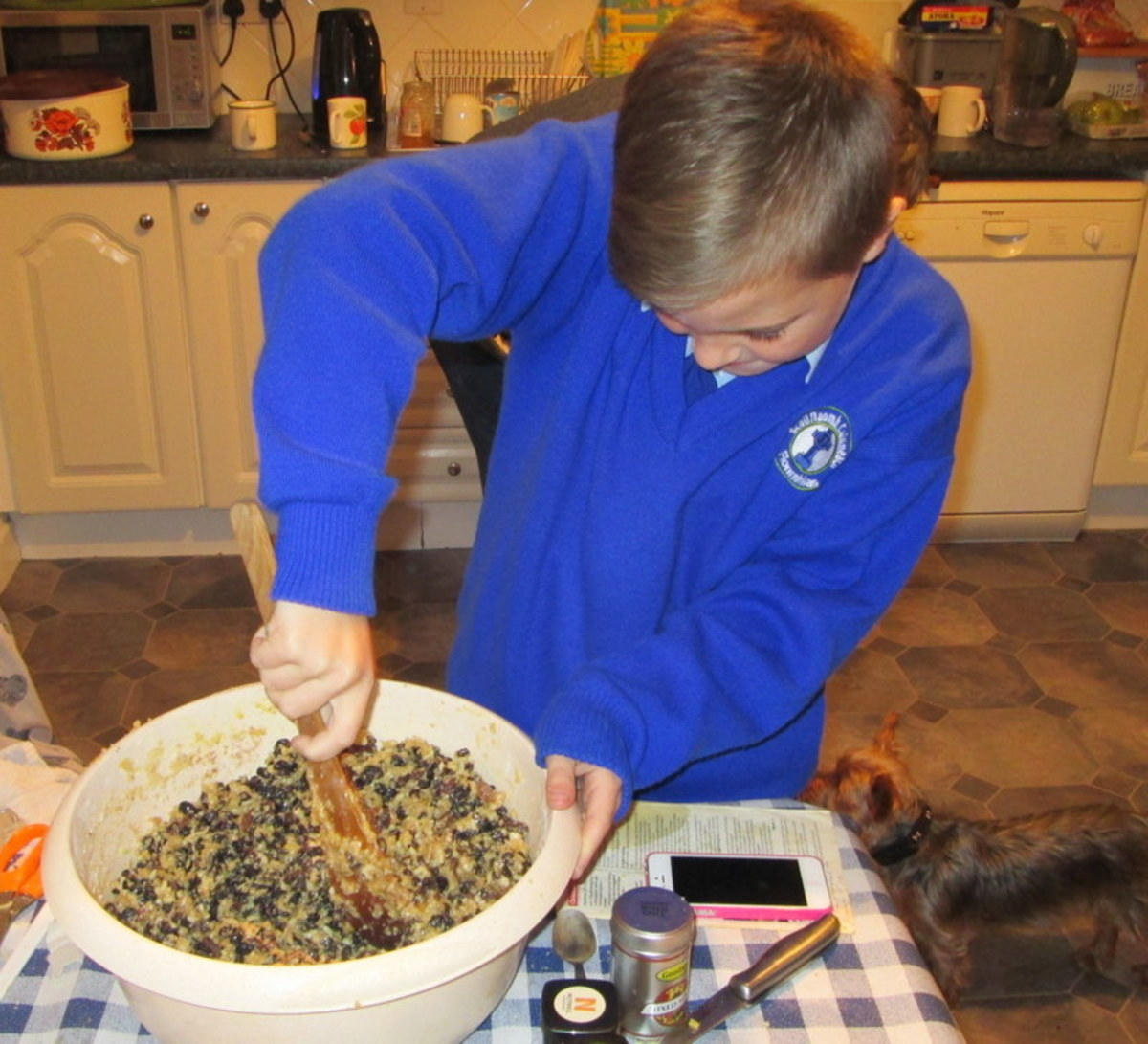 Stirring the Christmas plum pudding and making a wish - An Irish Christmas tradition