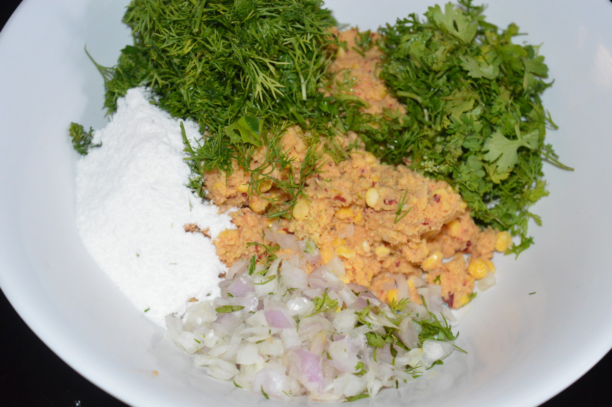 Step two: Take ground mix, rice flour, chopped onions,finely chopped dill leaves, coriander leaves, curry leaves, hing, hot oil, and salt. Mix well to make a firm dough.