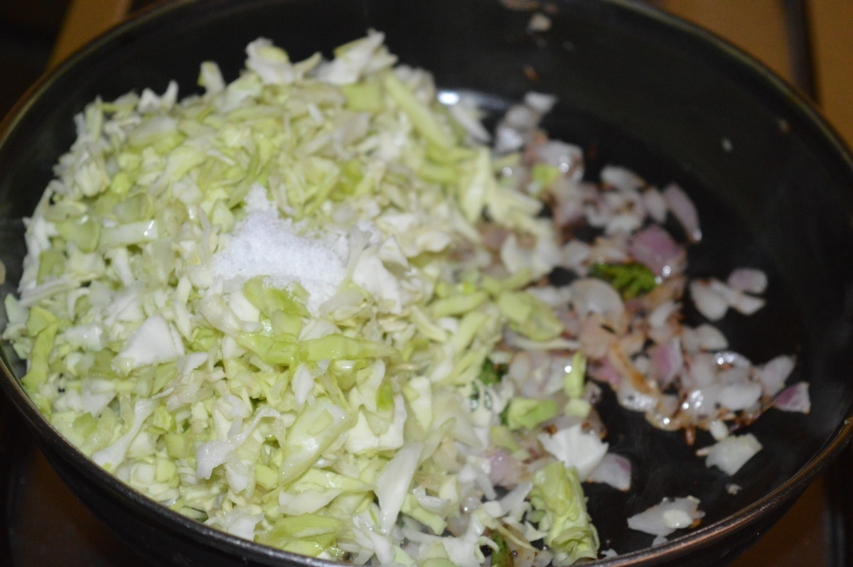 Step four: Add finely chopped cabbage and some salt. Stir-cook on medium-high fire for 2-3 minutes, stirring occasionally. Reduce the flame. Add a few drops of water if needed.