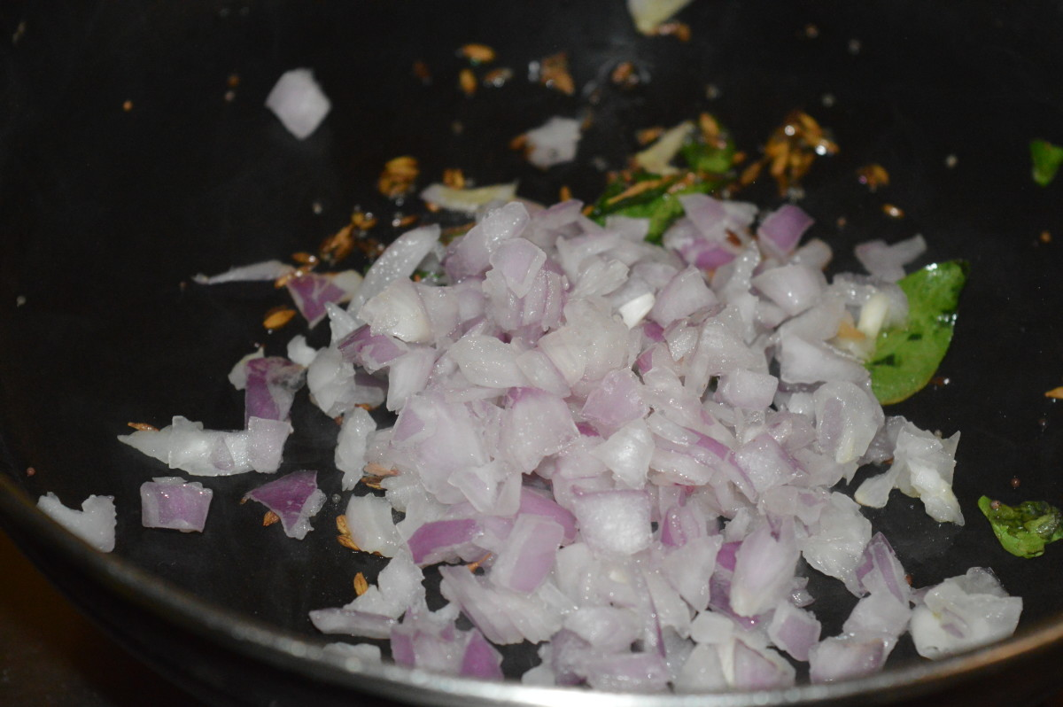 step three: Add chopped onions and chopped green chilies. Saute, till onions become transparent.