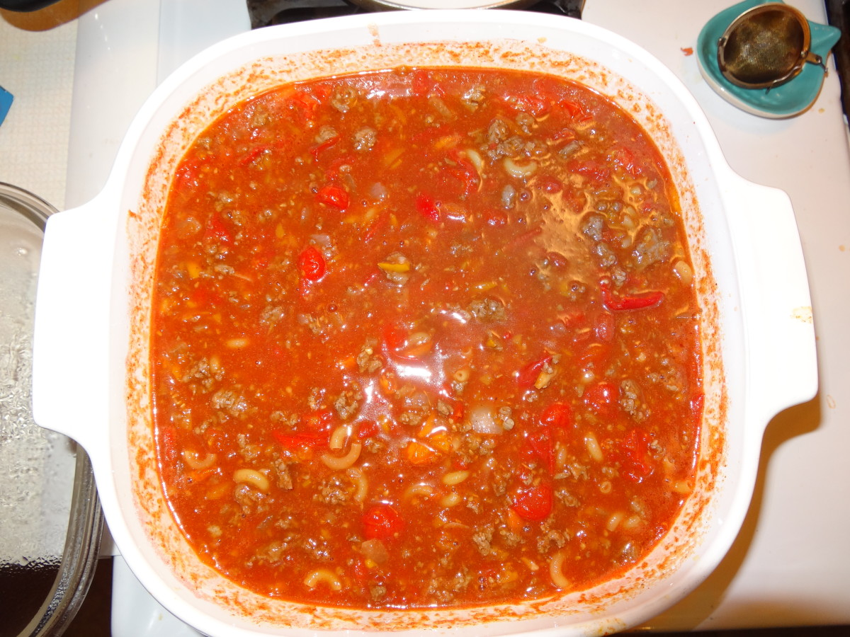 Add the meat, roasted tomatoes and peppers, bell pepper, and tomato juice to a large stock pot. Bring to a boil then add macaroni and chili beans, cook 7–10 minutes, stirring frequently. Remove from heat and stir in lime juice.