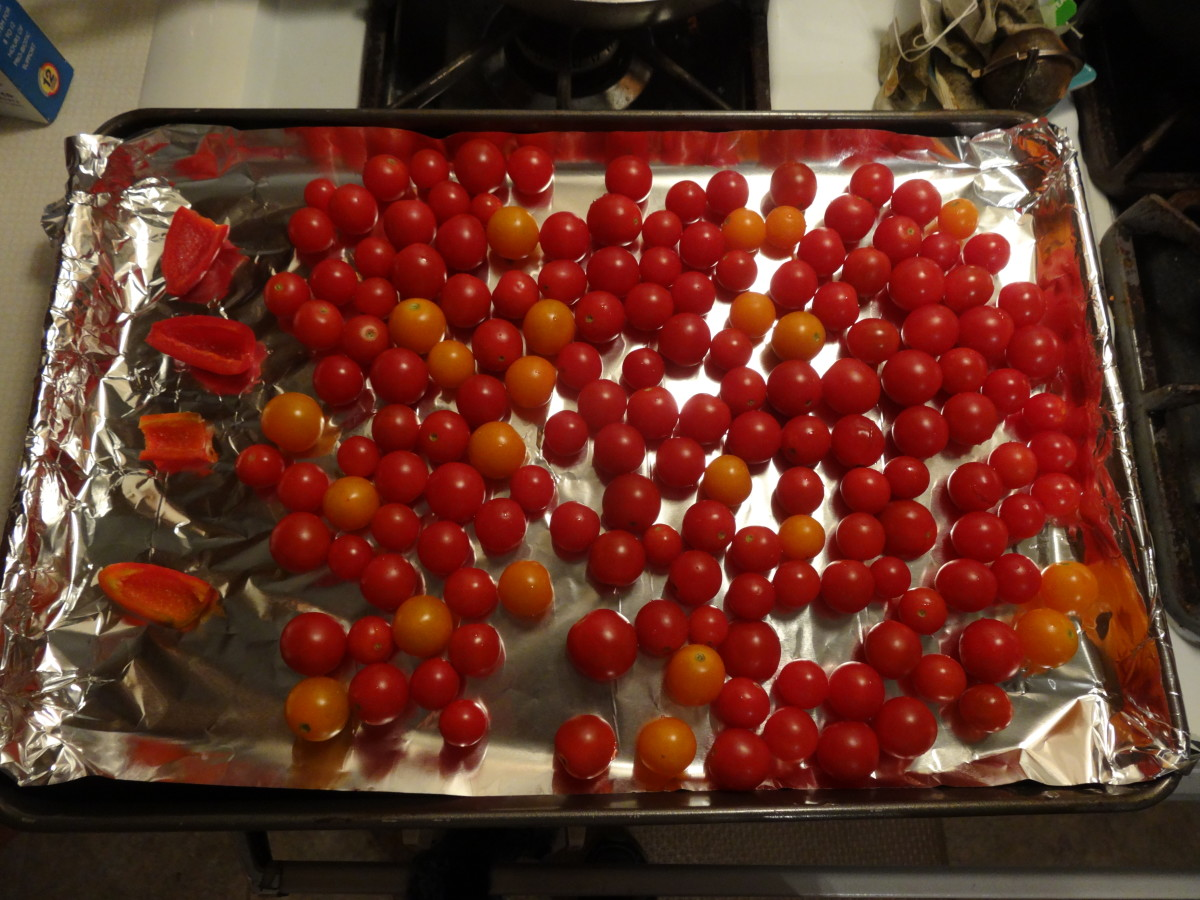 Place jalapeno pepper halves and cherry tomatoes in a single layer on an aluminum foil lined baking sheet.