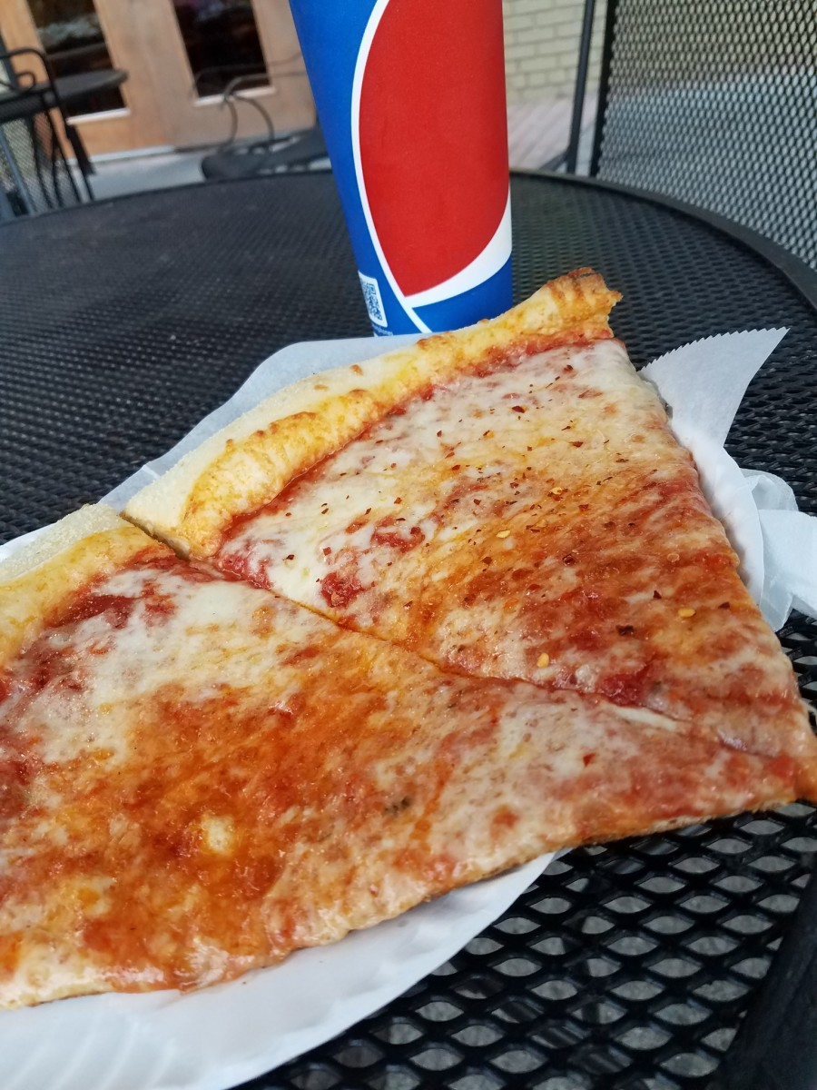 Nina's....formerly Mamma Nina's. 2 slices and a Pepsi for $4.00? I caught a deal on this day!