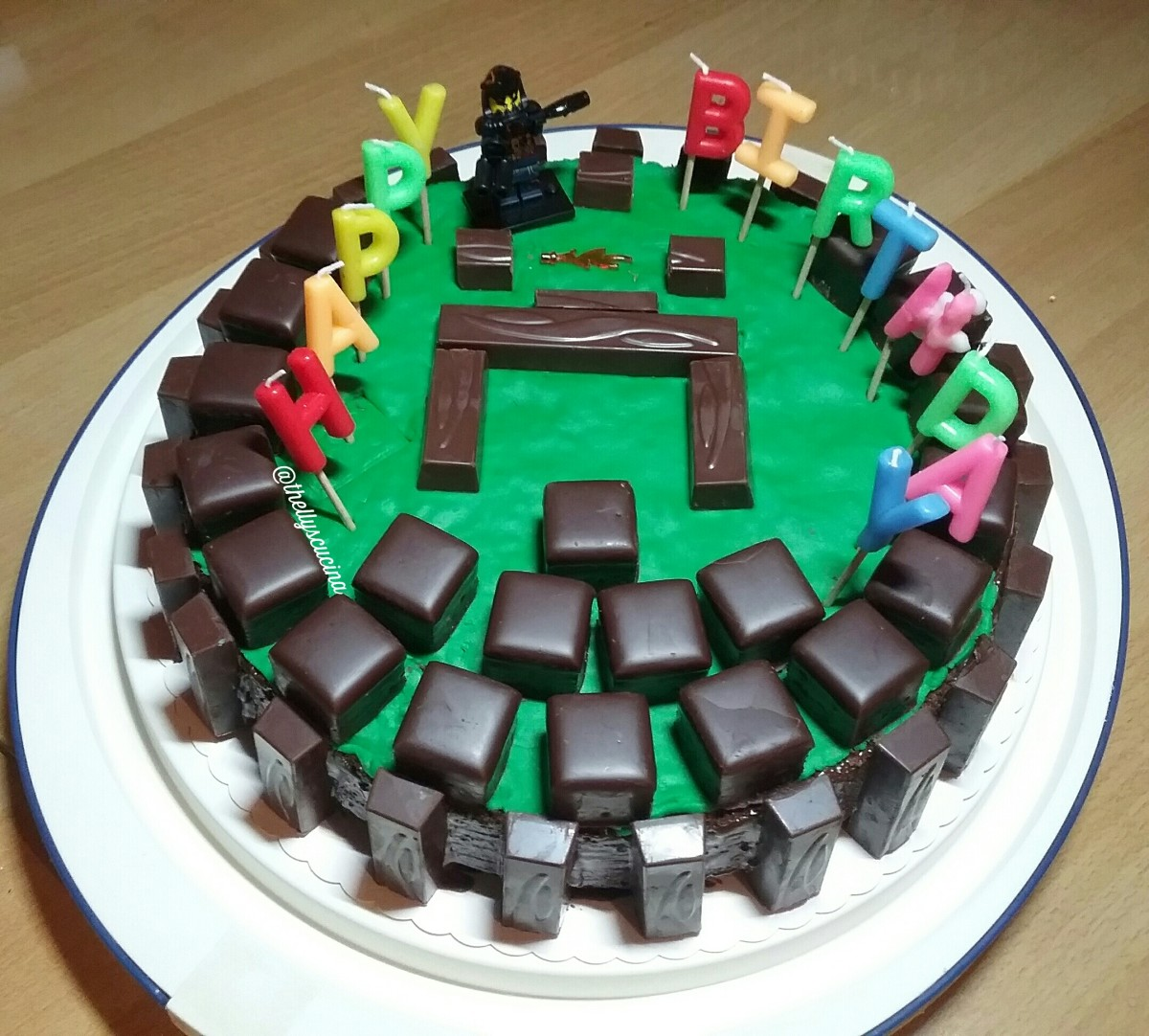 Then blocks of yummy chocolates were put on top making a circle and yes, just like building blocks of chocolates. A small warrior and a sword of Minecraft was added to the decorations. Then  happy birthday candles on the cake.