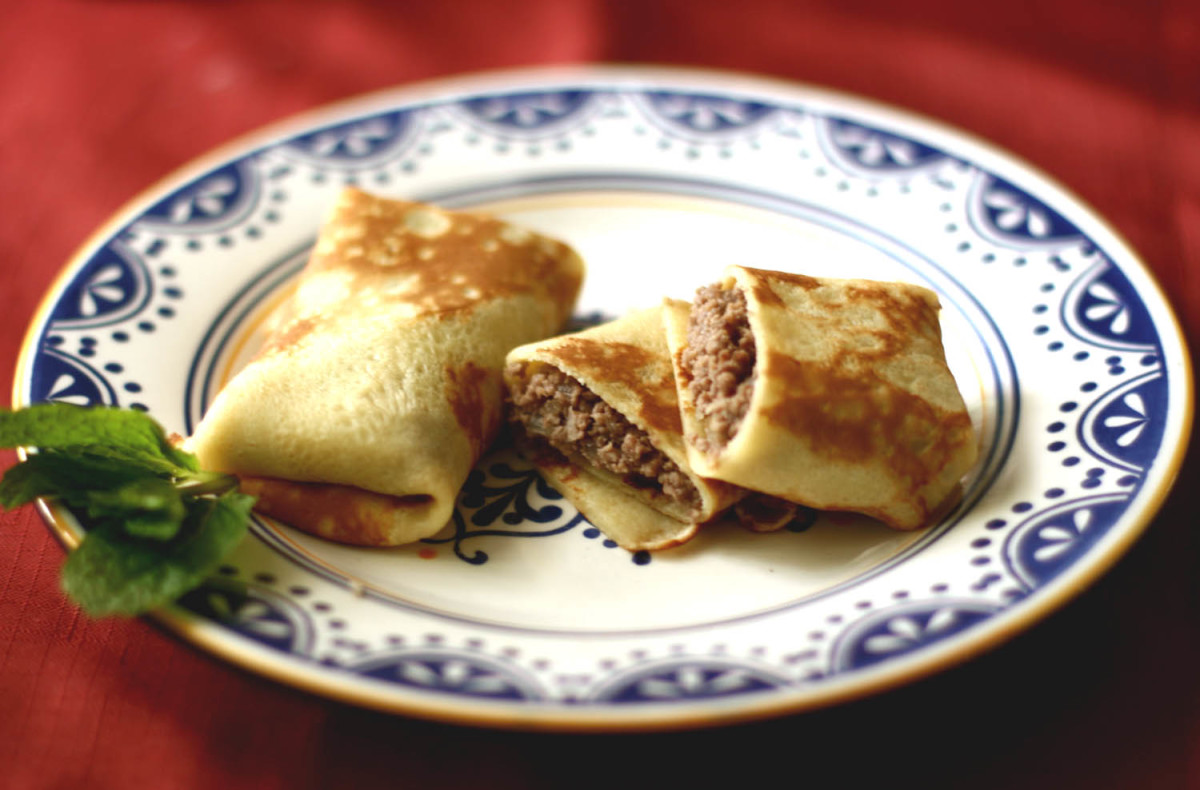 Blini stuffed with meat