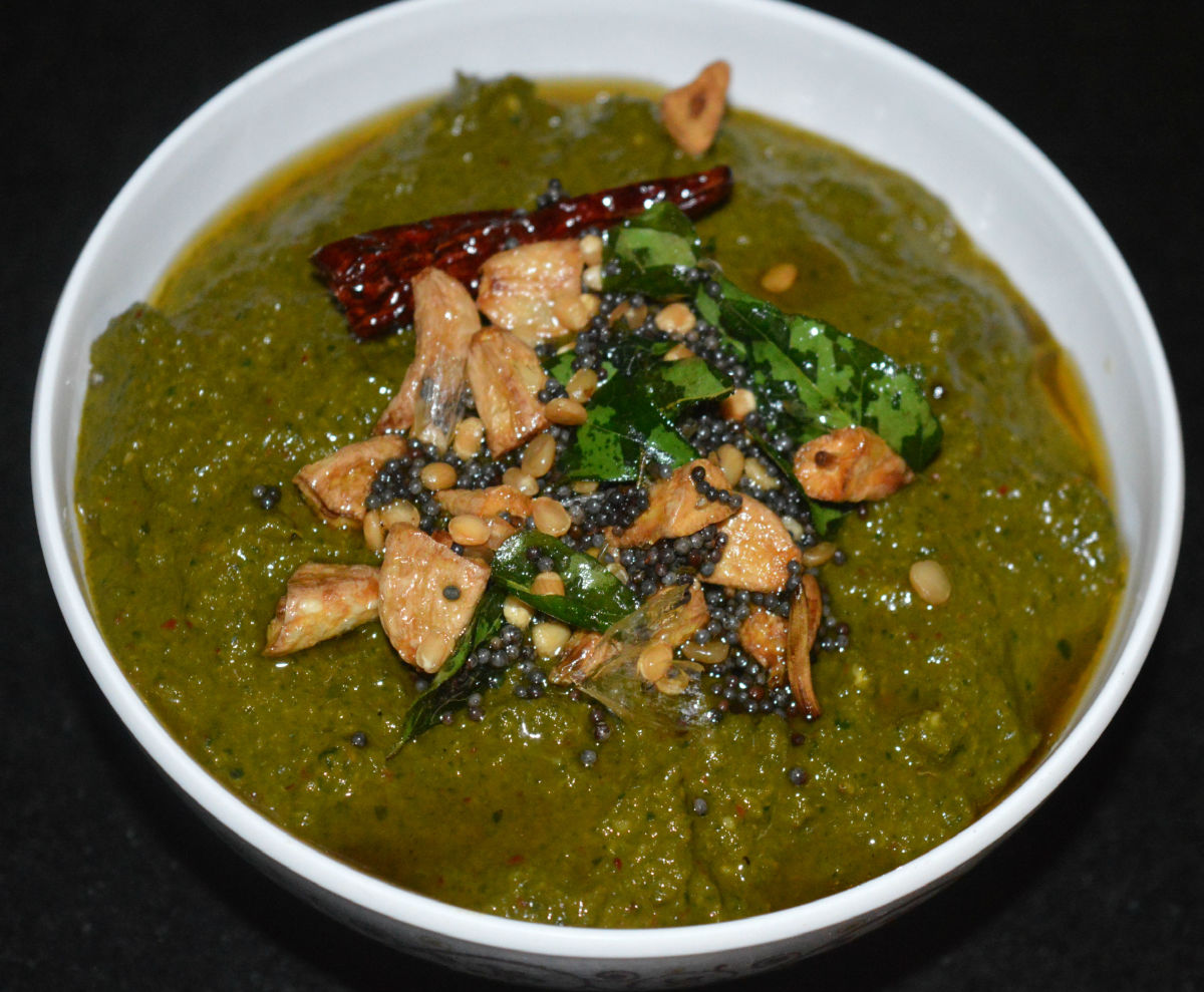 Step six: Pour the tempering on the chutney. Mix it at the time of serving. Moringa leaves chutney with garlic tempering is ready to serve!
