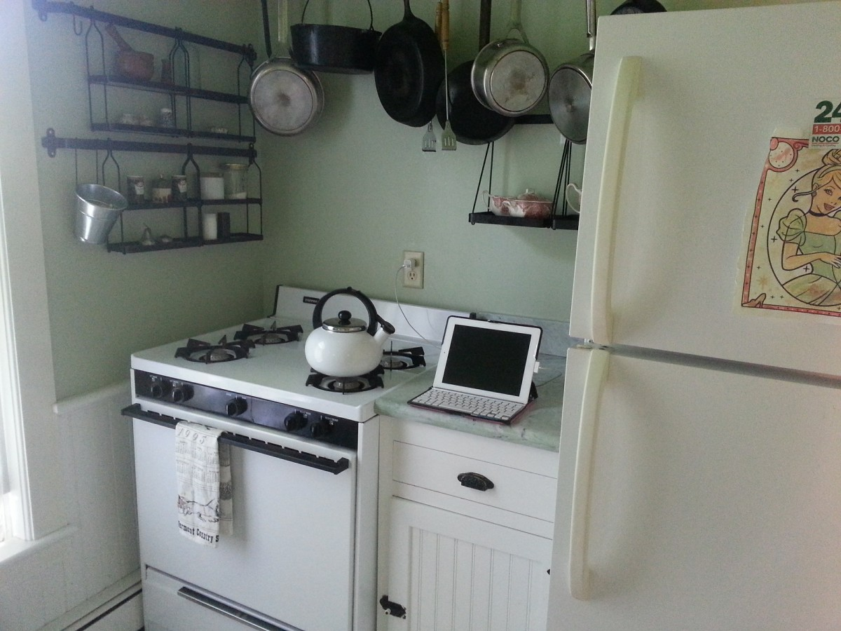 kitchen with a stove and fridge