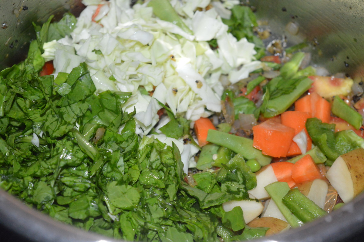 Step six: Add all chopped veggies and chopped coriander leaves. Throw in some salt. Saute for 2-3 minutes.