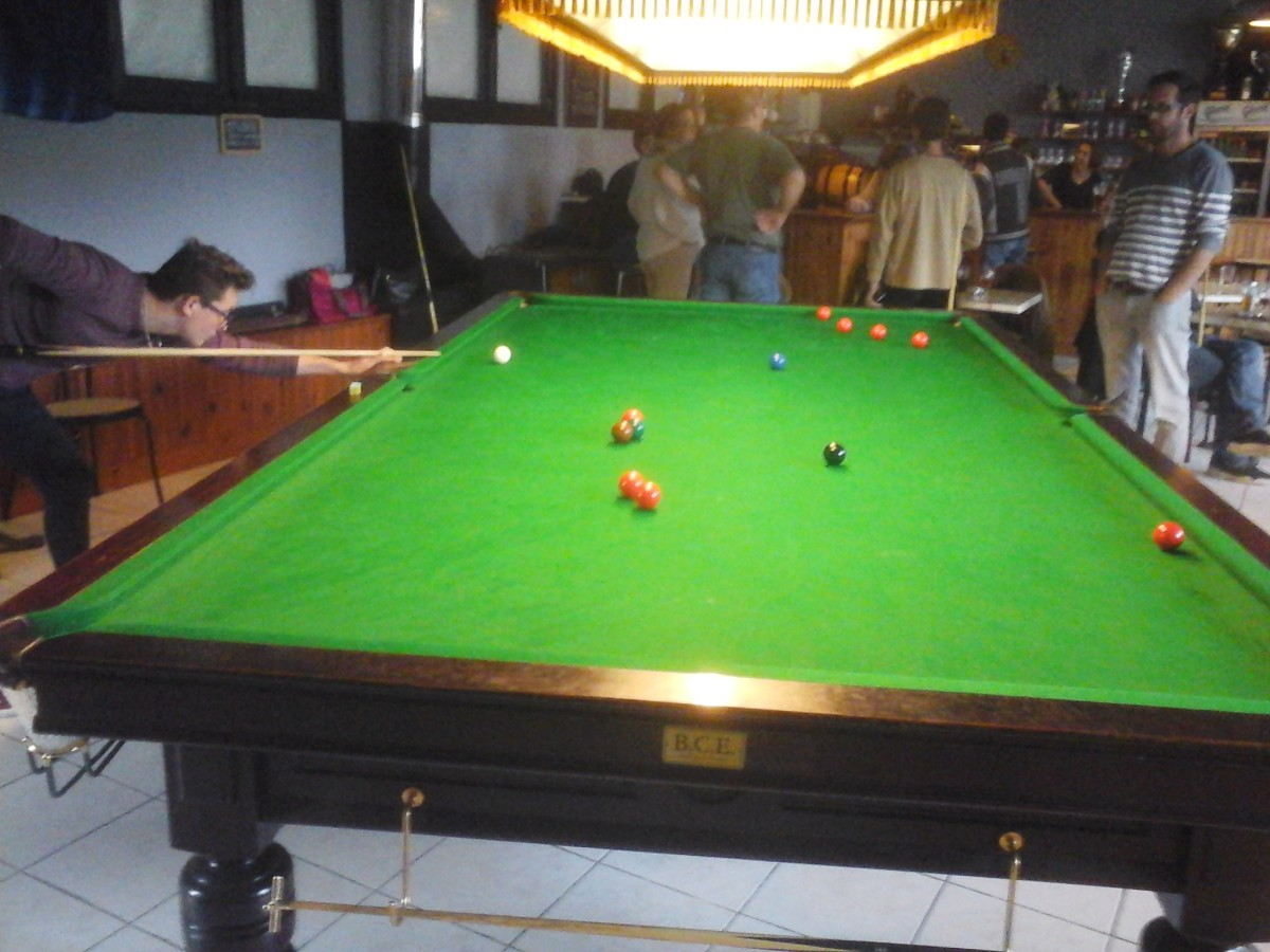 There is a full-sized snooker table.