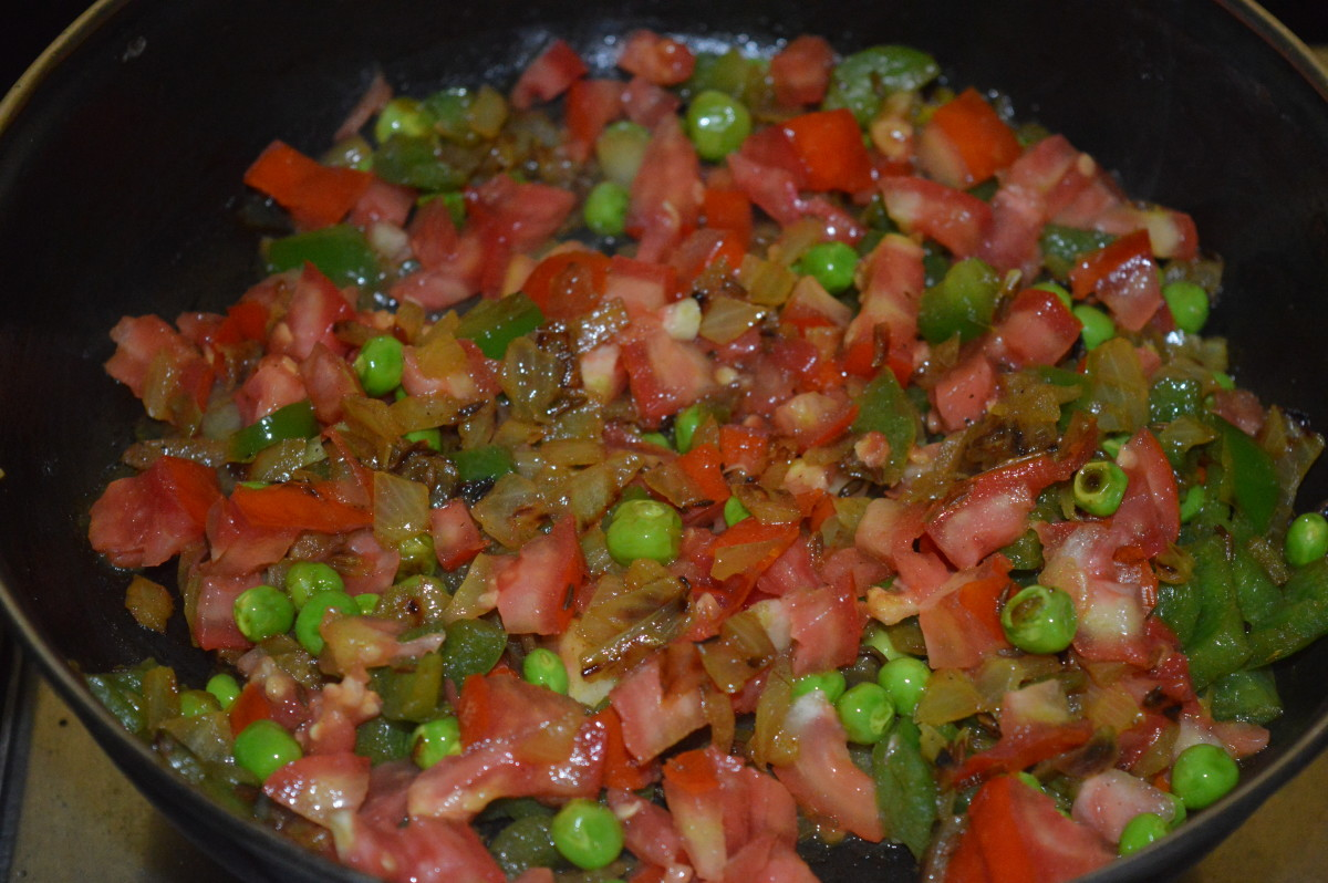 Step four: Add chopped tomatoes. Stir-cook on a high flame for 3 minutes or till they become soft, not mushy. Add some water to keep the mix moist.