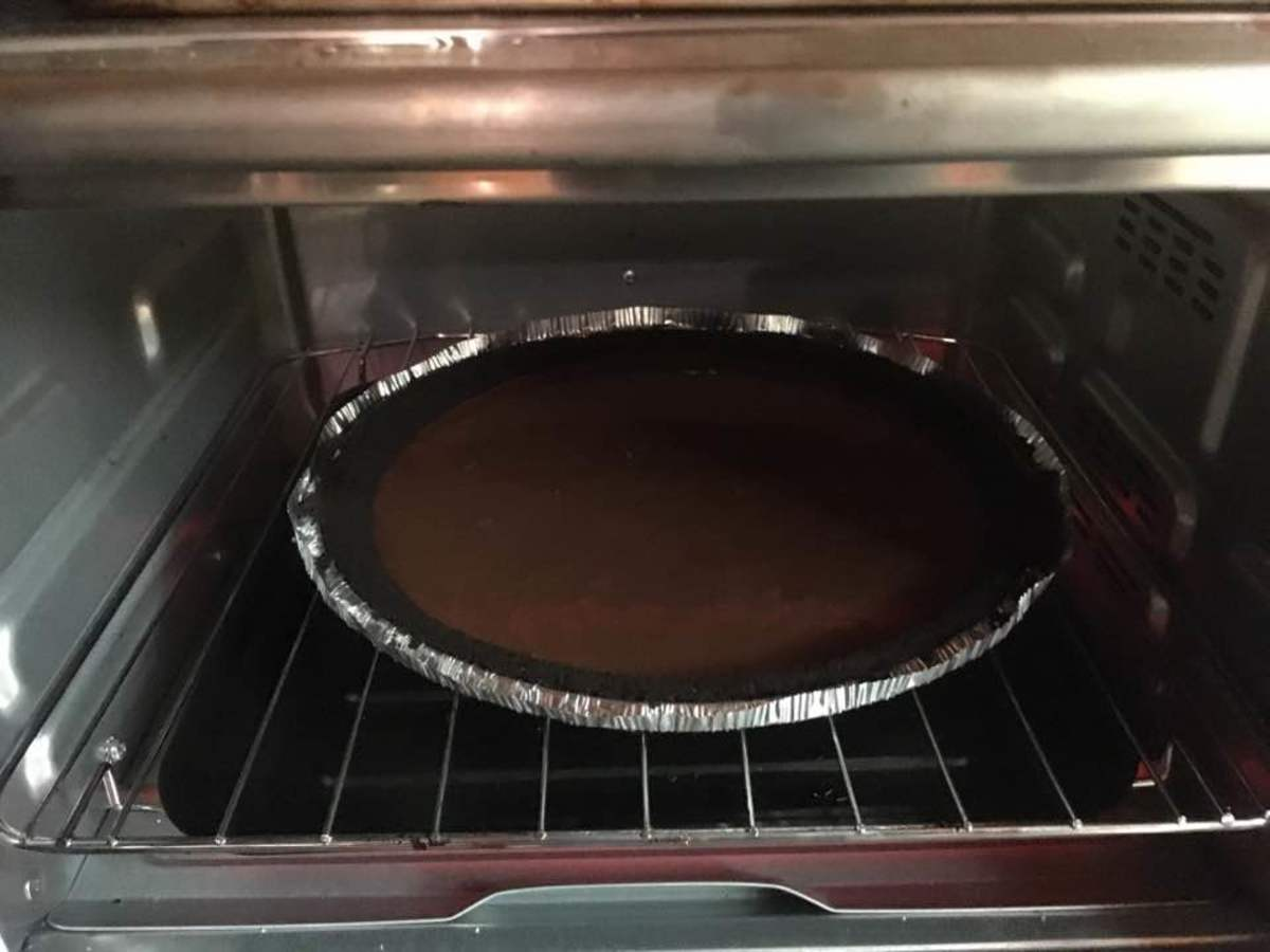 Baking the first pie in the oven.