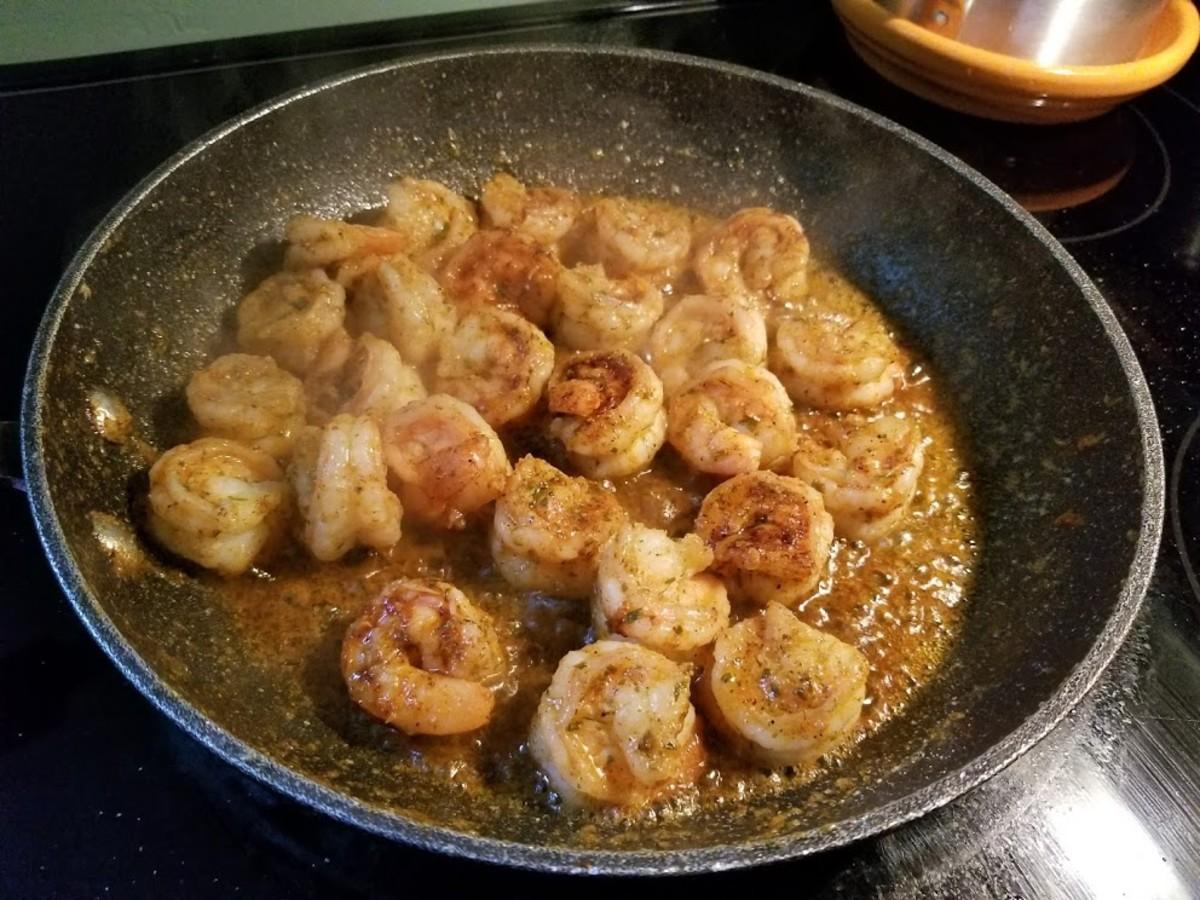 Delicious shrimp simmering in seasoned butter.
