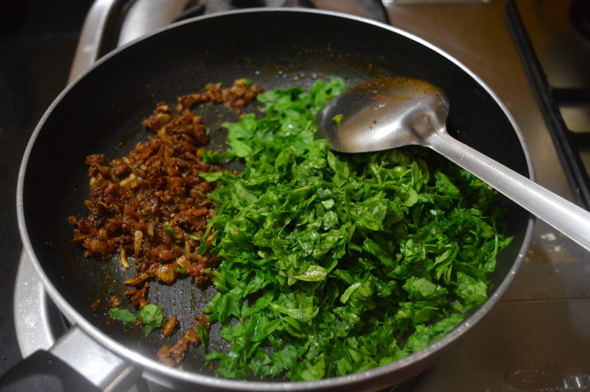 Step five: Add chopped fenugreek leaves. Mix well with the seasonings. Cover and cook till they are done.