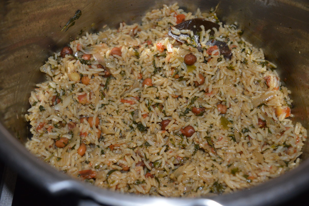 Step eight: Open the cooker lid when the pressure goes off completely. Gently mix it with a fork. This is methi chana pulav.