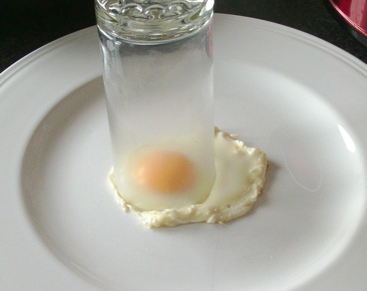 Drinking glass is used to cut circle from fried egg