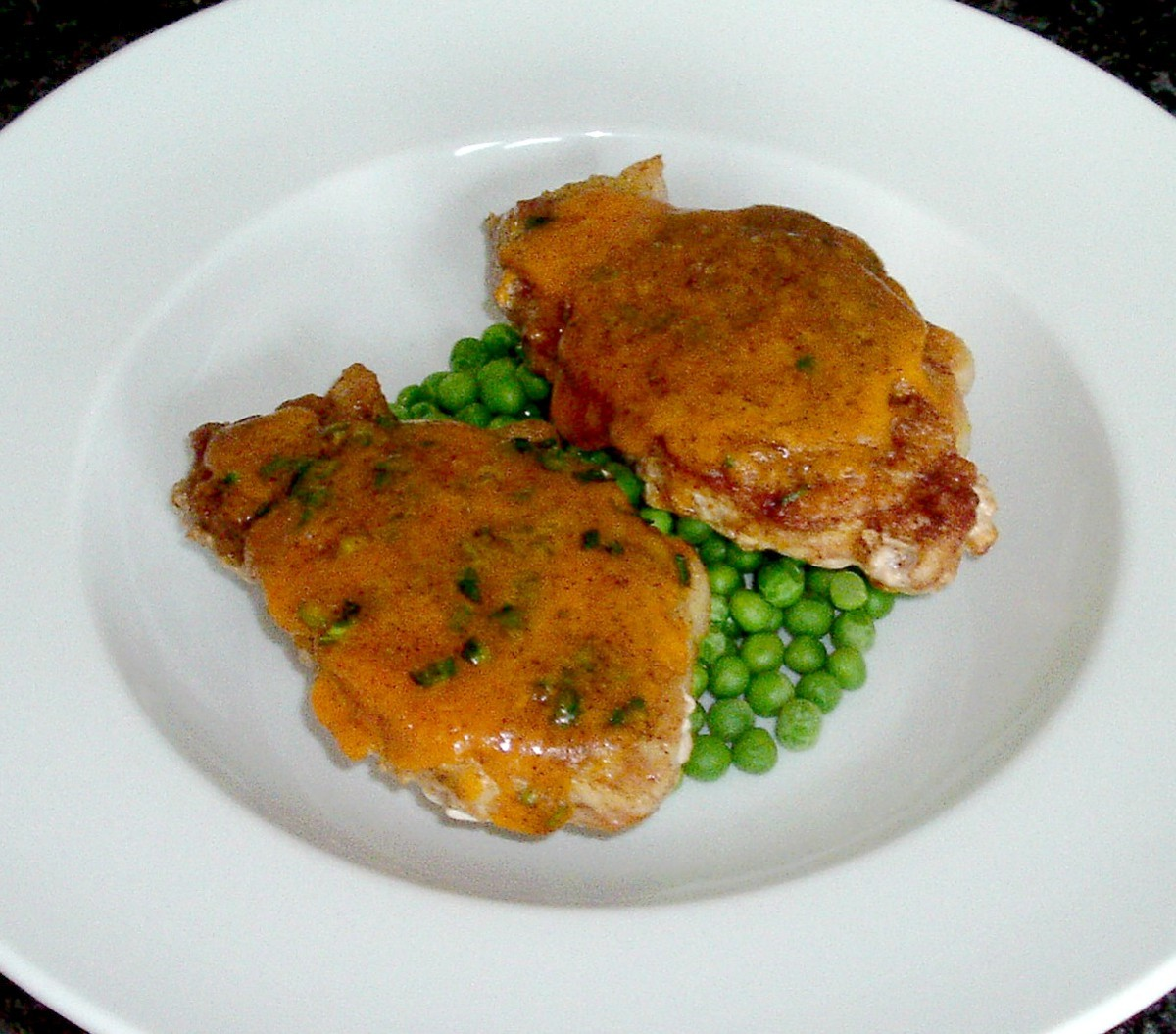 Spicy cheese pork steak tops each curried potato half