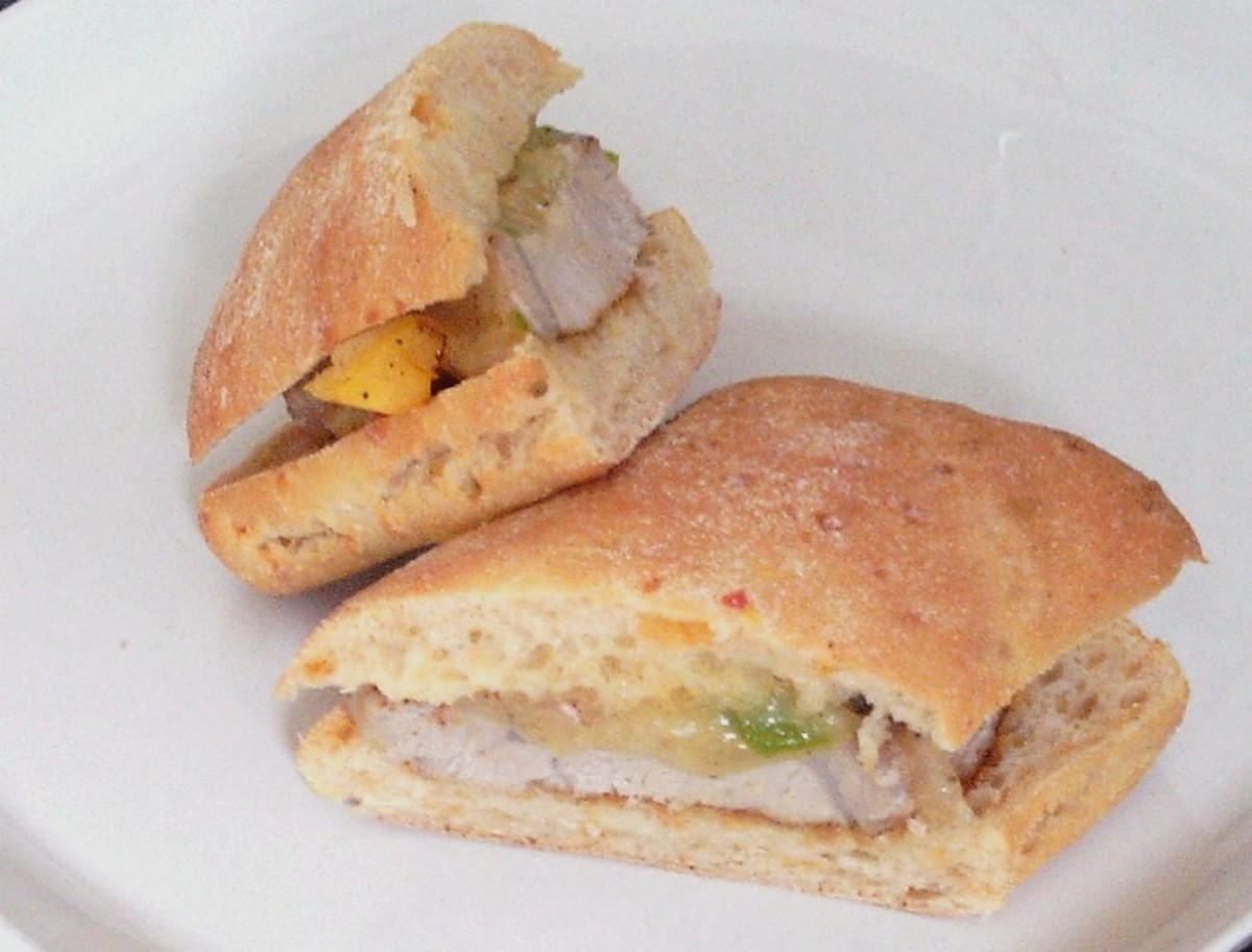 Pork steak sandwich with cheese and peppers