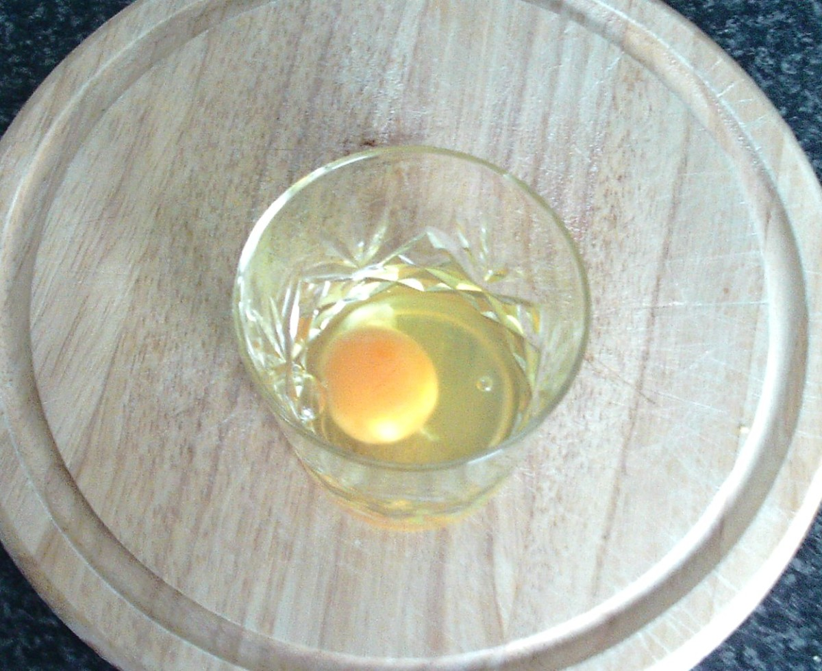 Egg for frying is firstly broken in to a small glass