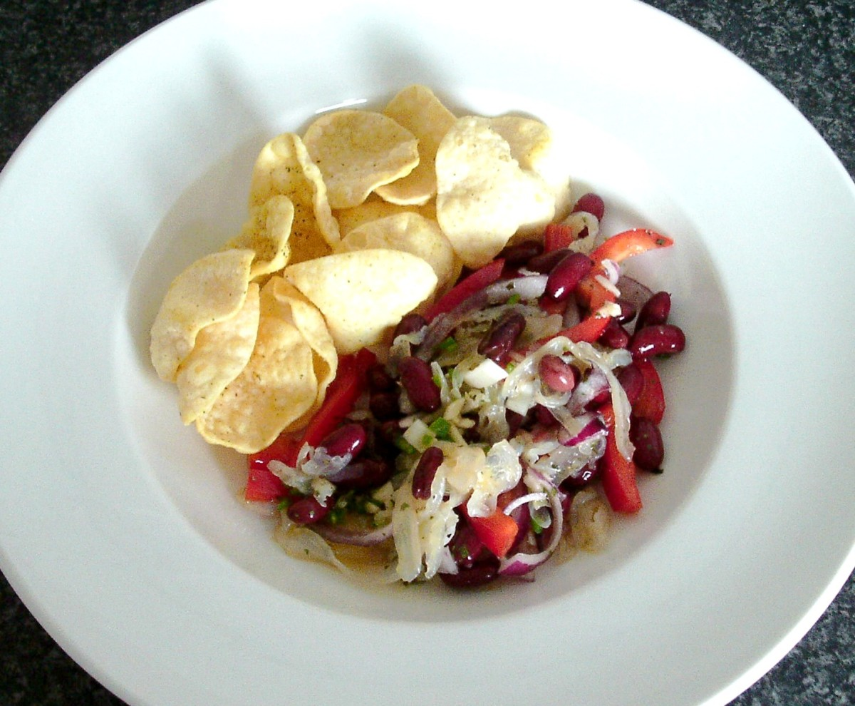 Jellyfish salad with onions, chillies and beans served with lime and coriander poppadoms