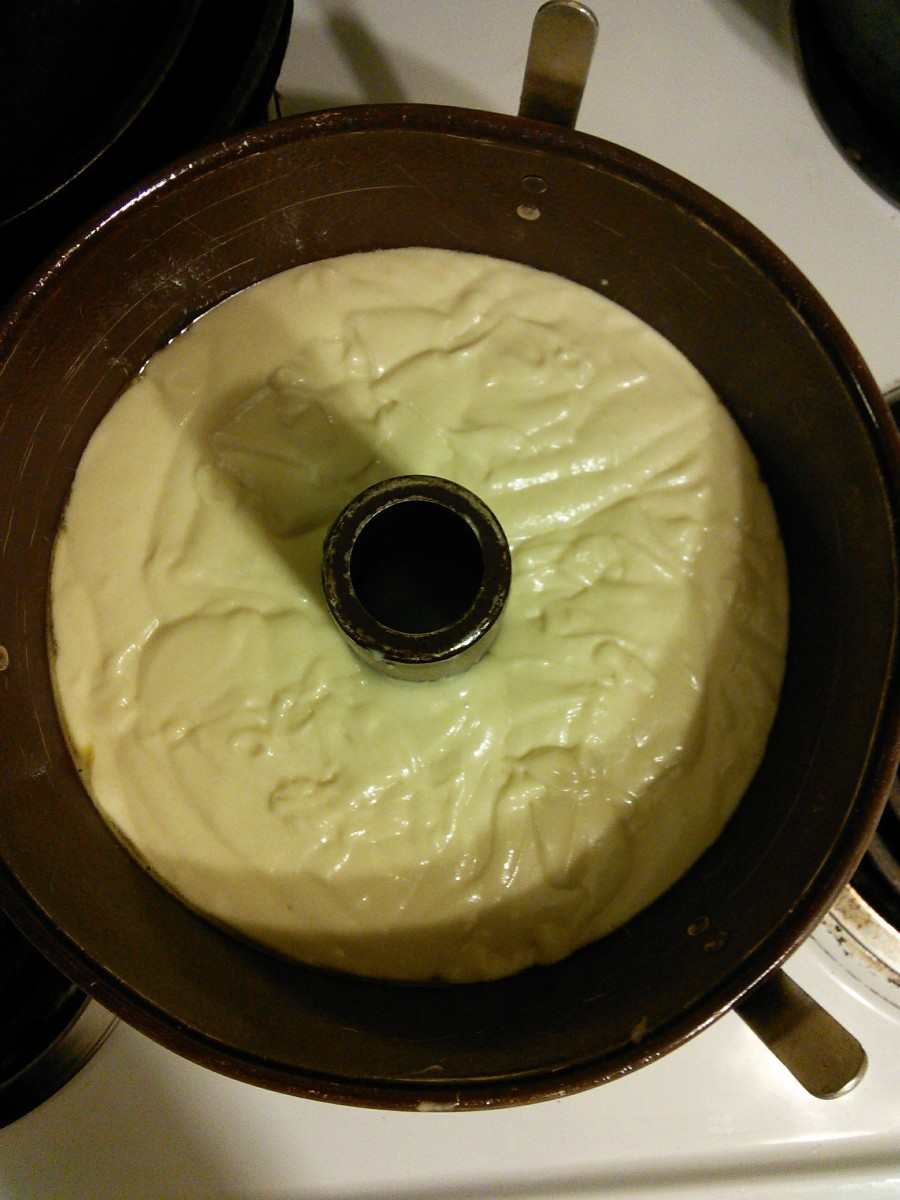Pour your batter evenly into your bundt pan. Shake it gently to level it out if need be. Bake it at 350 F for 1 1/2 hours. Do not peak at it until the timer says 30 minutes. Be very quiet about it.