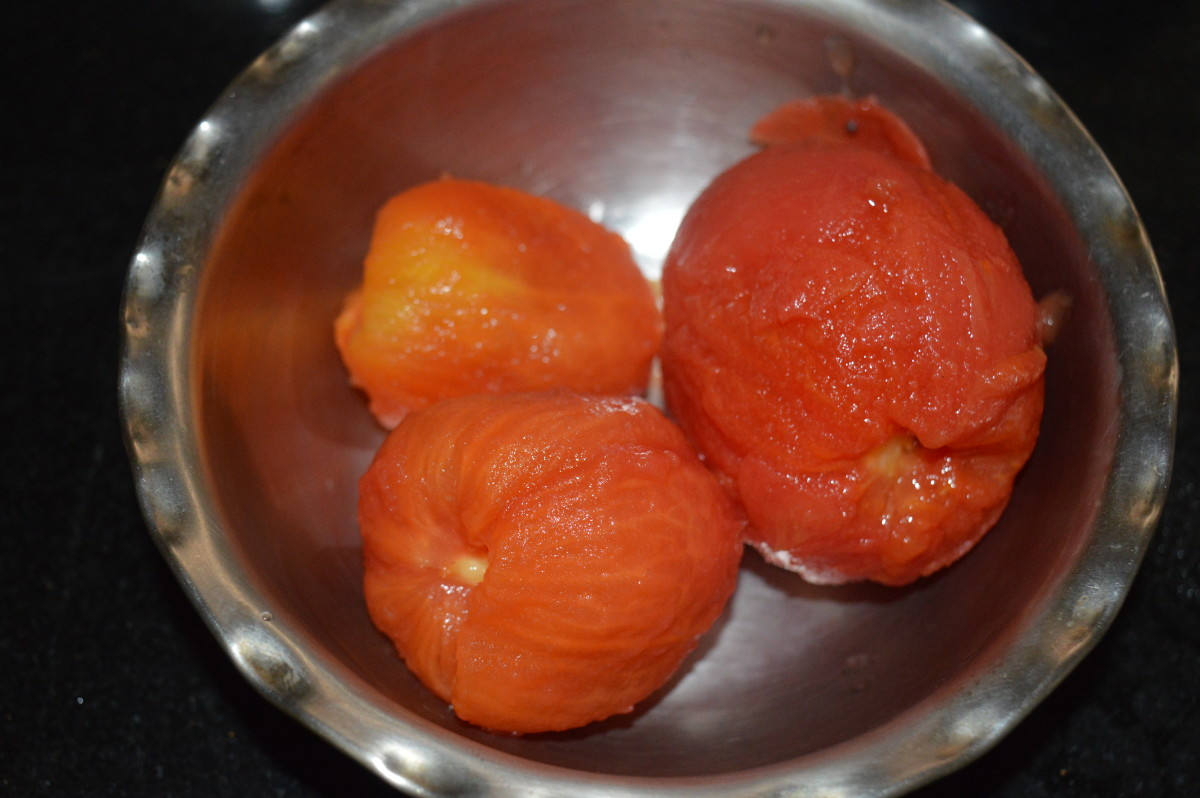 Step two: Further, take the tomatoes out. Now, the skin of the tomatoes would have shrunken. Keep aside for cooling. Remove the skin when they are warm or cold. Chop the flesh. Make a smooth tomato puree.