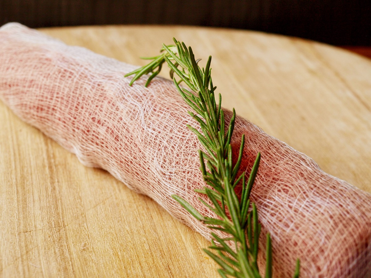 Wrap the cut in cheesecloth before you stick it in the refrigerator to dry age.