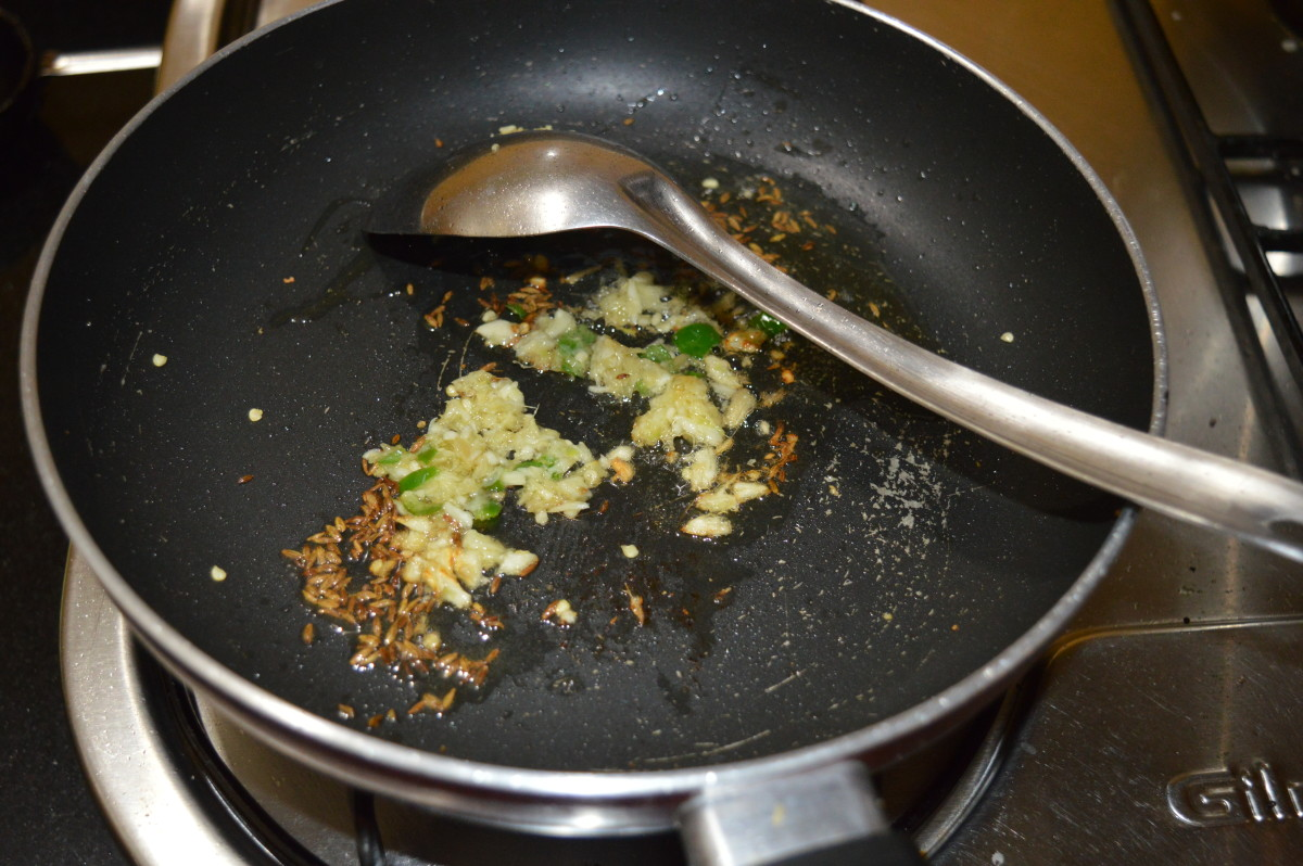 Step two: Saute cumin in oil until it sizzles. Throw in ginger-garlic-green chili paste. Saute for 30 seconds.