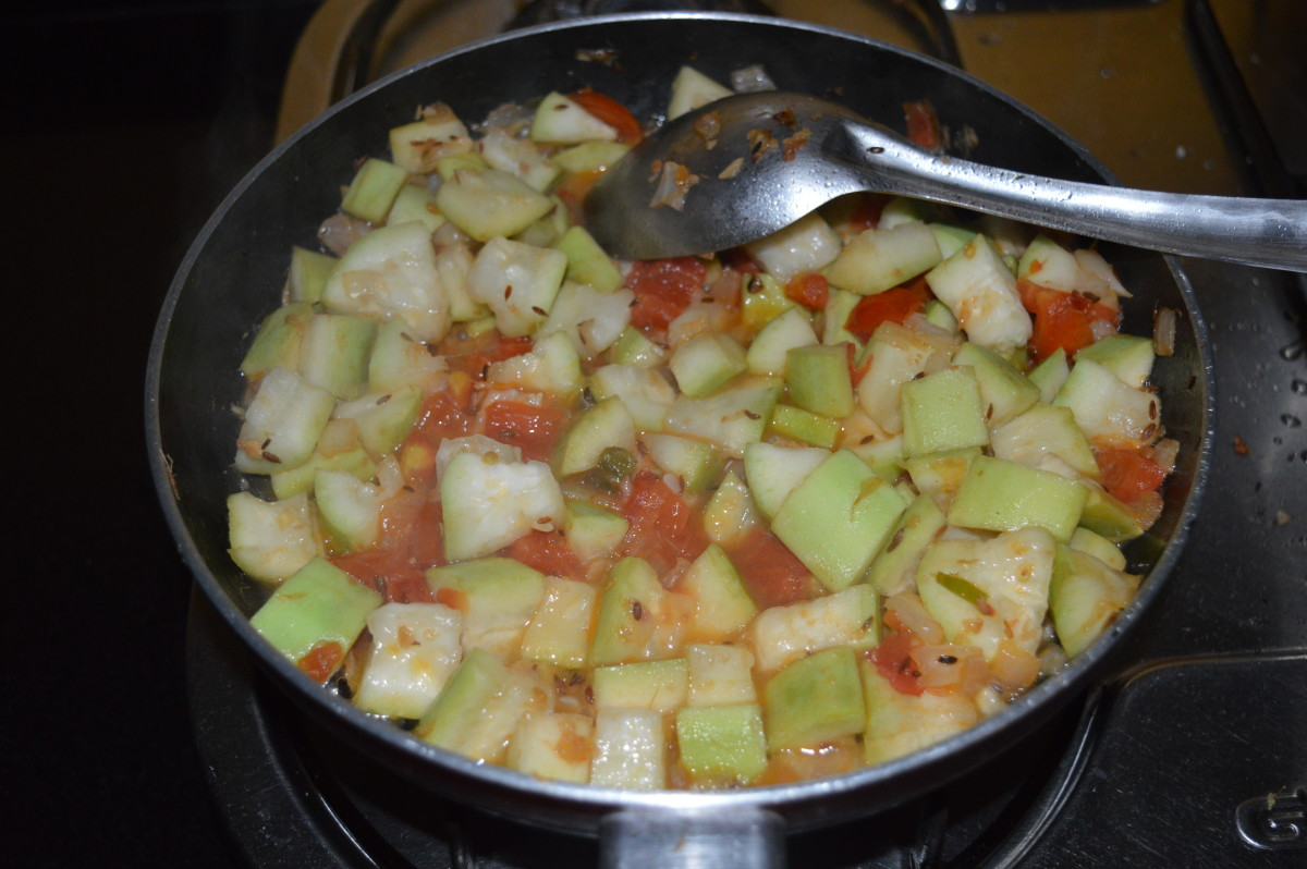 Step six: Add 1 cup water. Boil the mixture and cover the pan. Keep the heat low. Cook for 6-7 minutes or until bottle gourd becomes soft.