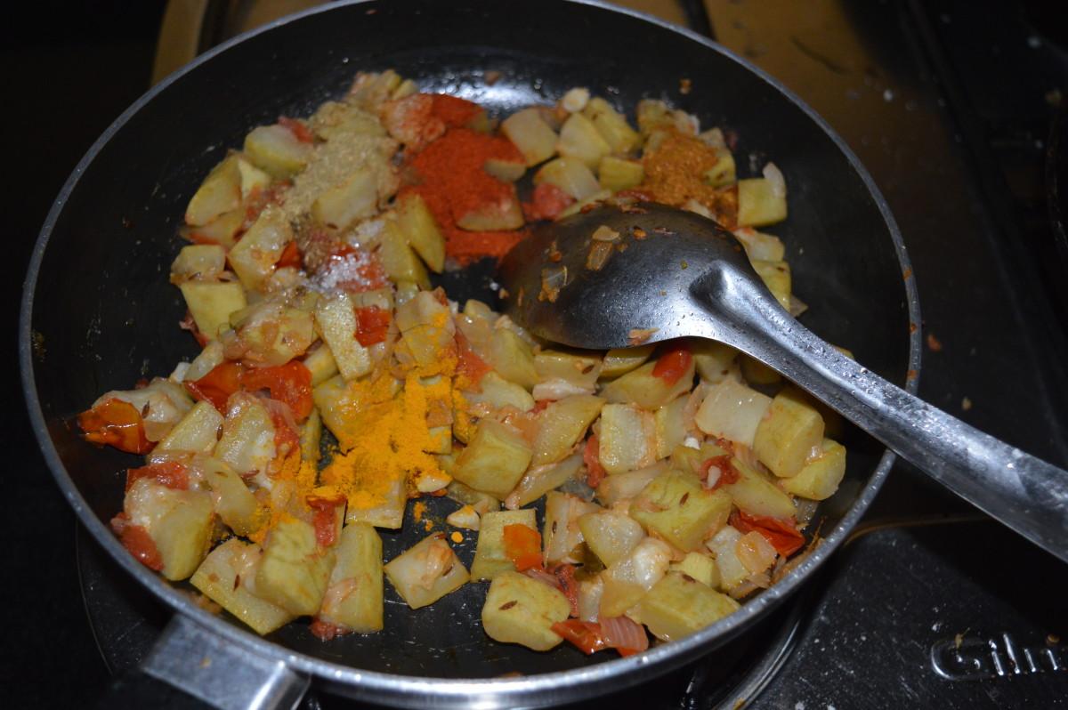 Step seven: Now, add all the spice powders, such as turmeric powder, coriander powder, garam masala powder, and red chili powder. Add sugar. Saute for two minutes.