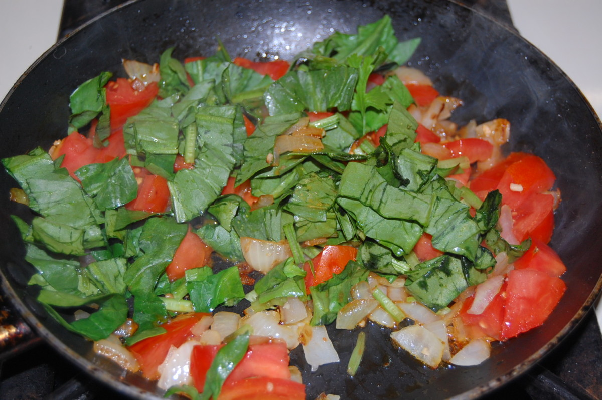 After the tomatoes are soft, add the spinach and dried parsley while stirring occasionally.  Allow to cook until the spinach has started to wilt.